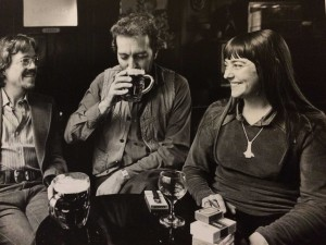 Image of Mirk Band members sitting in a pub