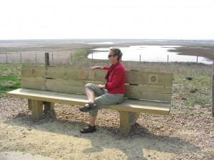 Saffron Summerfield sitting on her Soundbench at Rye Harbour