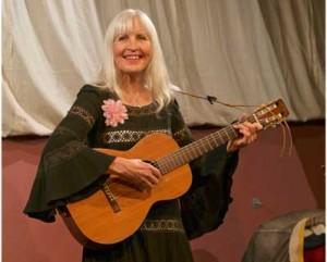 Image of Miriam Backhouse Playing Guitar & Singing